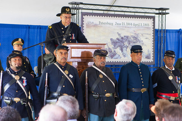 Members of the 54th in front of the stage during the stamp dedication ceremony.